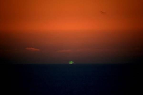 groene flits zonsondergang