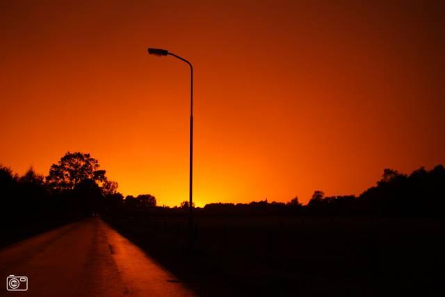 Oranje gloed aan de hemel